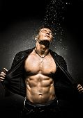 stock photo of cataract  - the very muscular handsome sexy guy under shower naked torso - JPG