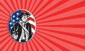 stock photo of muskets  - Business card template showing illustration of an American patriot minuteman revolutionary soldier with musket bayonet rifle and stars and stripes flag set inside ellipse done in retro style - JPG