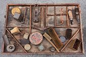 stock photo of work bench  - work table with old tools of the artisan shoemaker for repair cleaning polishing and finishing shoes - JPG