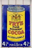 NR SOUTHAMPTON,UK - 25 June 2013: Old style tin advertising board for Fry's Cocoa displayed on paint