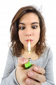 image of cigarette lighter  - Close up of a woman addicted to smoke lighting on a cigarette isolated on a white background - JPG