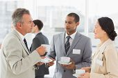 image of half-dressed  - Business people talking and having coffee at a conference in the office - JPG