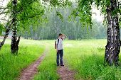 foto of knapsack  - teenager with knapsack get lost in summer forest - JPG