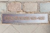 foto of pavestone  - Iron plaque of the Berliner wall near checkpoint Charlie - JPG