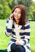picture of mongolian  - Mongolian lady talking on a phone vertical - JPG