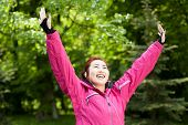 picture of mongolian  - Happy mongolian woman likes doing sport horizontal - JPG