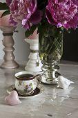 foto of pompous  - bouquet of peonies on the table tea break - JPG