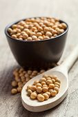 pic of soya beans  - Soya beans in a wooden spoon and a black bowl