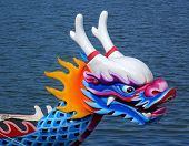 stock photo of dragon head  - A dragon boat decorated in traditional manner with a dragon head sculpture - JPG