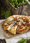 picture of sorrel  - Homemade Flatbread With Sorrel and fresh sorrel on table - JPG
