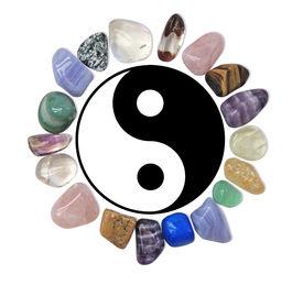 picture of semi-circle  - Circle of healing crystals around Yin Yank symbol on white - JPG