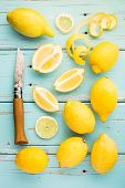 stock photo of slit  - Fresh lemons and lemon zest on the old table - JPG