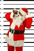 Постер, плакат: BUSTED Santa Claus is arrested and his MUG SHOT taken at the Police Station Santa was a Bad Bad bo