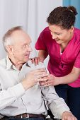 foto of hospice  - Disabled man drinking water in a hospice - JPG
