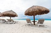 image of beachfront  - Sun umbrellas and chairs on Caribbean beach Cancun Mexico - JPG