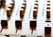 foto of controller  - Sound mixer controller with knobs and sliders closeup