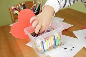stock photo of arts crafts  - Child kid engaged in arts and crafts activity creative learning and education concept - JPG