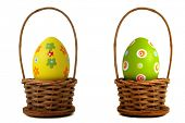 stock photo of bassinet  - Yellow Easter egg into a basket on white background - JPG