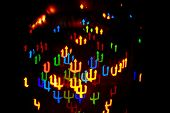 picture of trident  - Multicolored abstract background of lights in the form of a trident is not in focus - JPG
