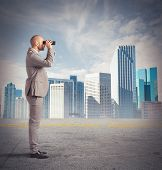 foto of observed  - Businessman observes from a distance with binoculars - JPG