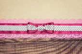 picture of wood craft  - vintage background with wood old paper and pink and white polka dot ribbon with bow - JPG