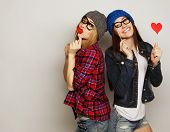 stock photo of party hats  - two stylish sexy hipster girls best friends ready for party - JPG
