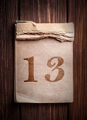 pic of 13 year old  - Old calendar with digit on a wooden background - JPG