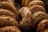 stock photo of bagel  - Basket full of  bagels with shallow dept of field - JPG