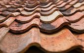 stock photo of roofs  - The old roof covered with orange tiles - JPG
