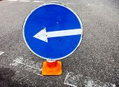 foto of turn-up  - Turn left sign on the traffic cone - JPG