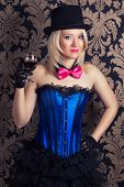 foto of cabaret  - beautiful cabaret woman holding a glass of red wine against retro wallpapers - JPG