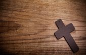 picture of crucifix  - wooden cross on a wooden brown background - JPG