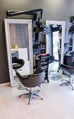 picture of beauty salon interior  - Closeup of customer seat inside of empty modern hair and beauty salon - JPG