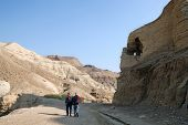 stock photo of israel people  - Two tourists in a rocky desert - JPG