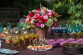 picture of centerpiece  - Table setting at a luxury wedding or another catered event - JPG