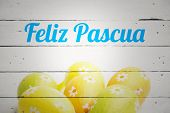 stock photo of pasqua  - feliz pasqua against six easter eggs together - JPG