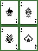 stock photo of ace spades  - Aces of Spades in four versions on a green background  - JPG