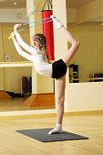 image of skipping rope  - Little gymnast working out in gym with skipping rope - JPG