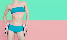 image of shale  - Fitness girl in fashionable sports swimsuit on vanilla background - JPG
