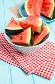 image of watermelon slices  - Closeup of watermelon slices on wooden vintage background - JPG