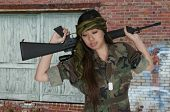 stock photo of rifle  - Beautiful young woman soldier with a M16 rifle - JPG