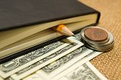 image of memento  - notebook with a blank sheet pencil and money on the old tissue - JPG
