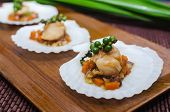 stock photo of scallop shell  - Seared scallops  served on a bed of vegetables - JPG