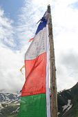 image of buddhist  - Large Buddhist flag fluttering in the wind - JPG