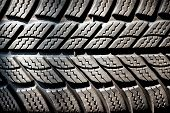 picture of motor vehicles  - Detail of a winter tire tread on a new motor vehicle tire designed to operate at lower temperature and give additional grip and friction in snow and wet - JPG