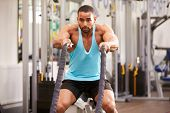 stock photo of battle  - Young man prepares for work out with battle ropes at a gym - JPG