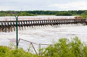 pic of dam  - Small dam on the river background sky - JPG