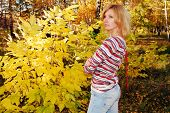 Pretty woman in the autumn park.