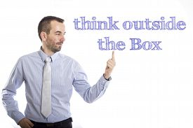 image of thinking outside box  - Think outside the Box Young businessman with small beard touching text - JPG