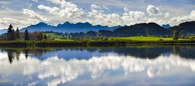 foto of bavaria  - panorama landscape in Bavaria with alps mountains mirroring in lake